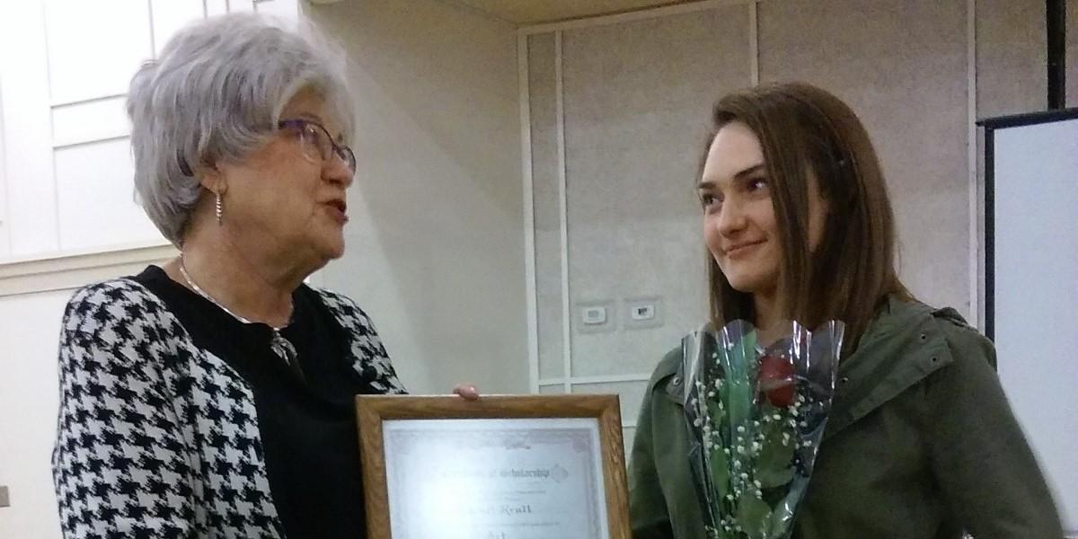 RAA Dawn Thomas hands Rachel Krulls her 2016 scholarship award.