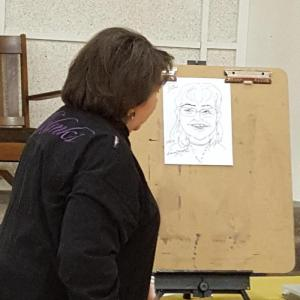 Nancy Mathis teaches caricature drawing.